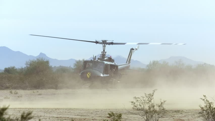 Huey helicopter taking off from the desert, in slow motion - HD stock video clip