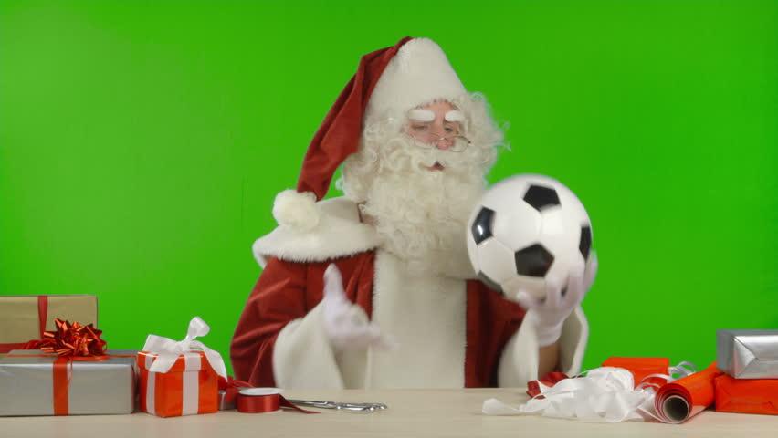 Santa sits on a football soccer ball ambient movement
