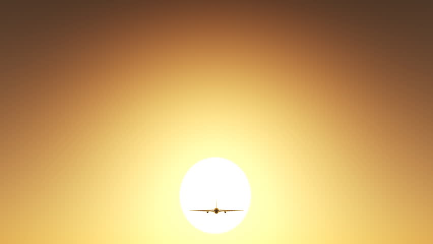 Airplane flying in sunset sky.