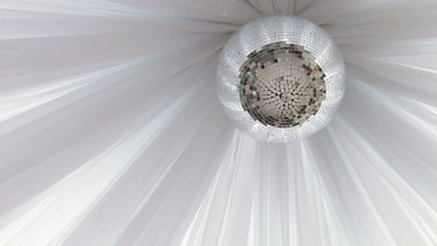 On a background of white cloth mirror ball on the ceiling