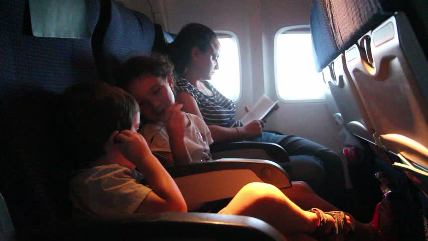 Kids on airplane during flight  - HD stock footage clip