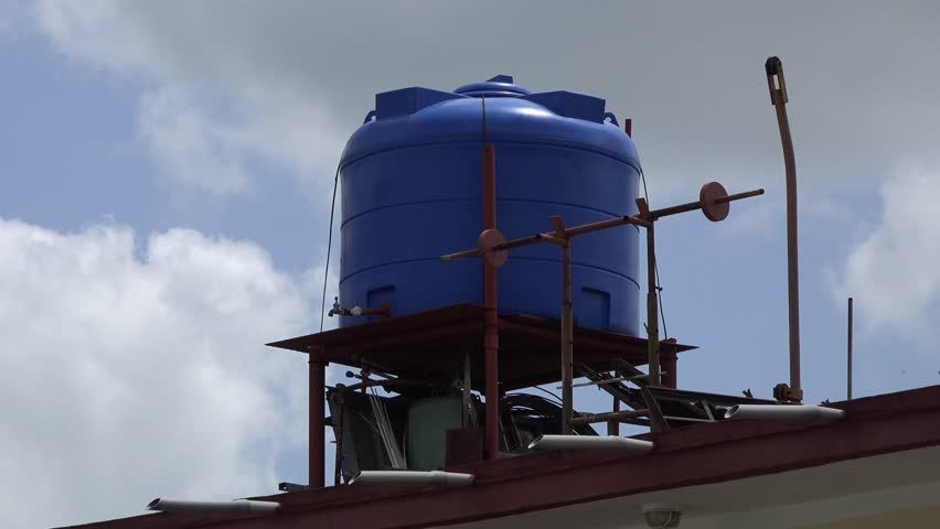 SANTA CLARA,CUBA-AUGUST 5, 2014: Elevated water tank in a Cuban house. Problems with the water supply has forced many to save their own and treat it because the country is sufffering from cholera.