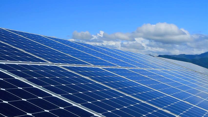 Solar panels array over a sky. Time lapse.