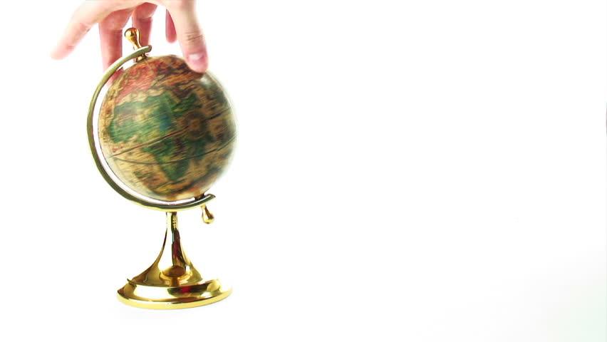 Spinning old globe isolated on white background