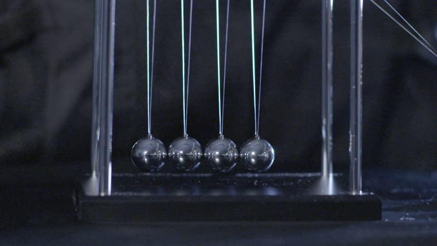Newton's Cradle, Desk toy pendulum, slow motion, black background - HD stock video clip