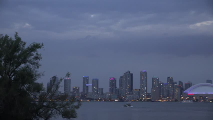 Toronto Skyline views during the twilight on a cloudy day all seen from the Centre Island. The Toronto Skyline is a tourist landmark and one of the most photographed places in North America.