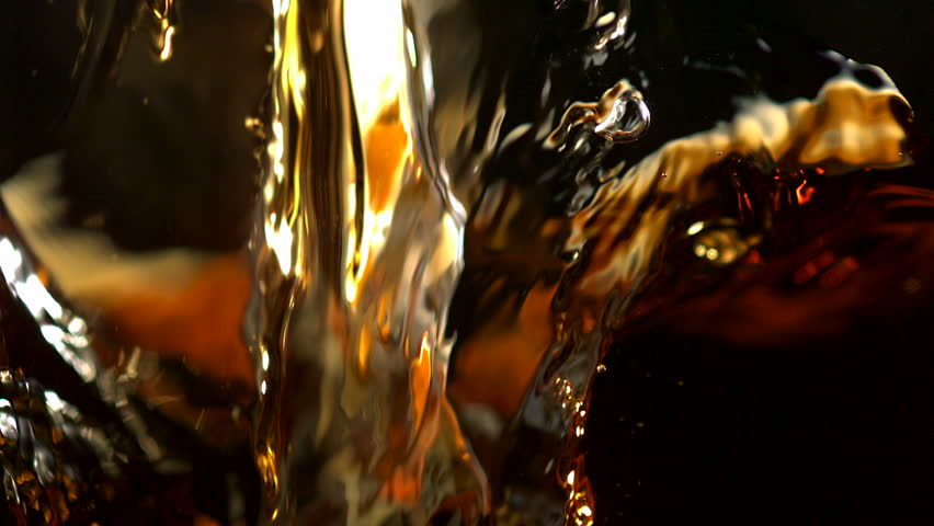 Pouring brown color liquid shooting with high speed camera, phantom flex.