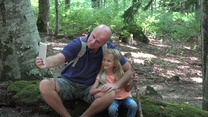 4K Father, Man, Child Taking Selfie on Tablet PC, Happy Smiley Family Relaxing, Playing with Touchscreen in Mountains Trail, Path, Little Girl and Daddy in Summer Vacation, Trip, Camping - 4K stock video clip