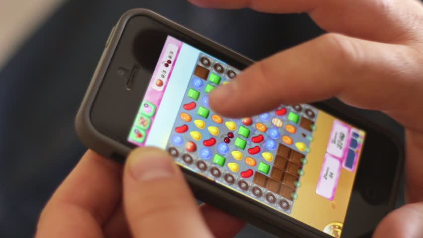 Tel-Aviv, ISRAEL - MAY 1: Playing Candy Crush game on iPhone 5,  on May 1, 2014 in Jerusalem, Israel. Candy Crush Saga is a match-three puzzle video game.