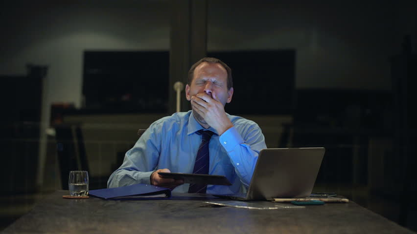 Man Businessman Types On Laptop In Home Office After