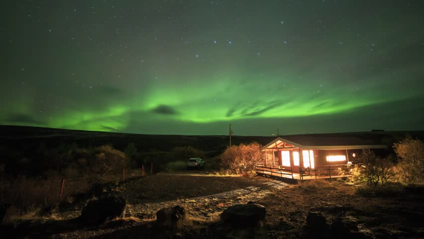 Aurora in Iceland over a cabin at Fljotstunga. Timelapse footage.