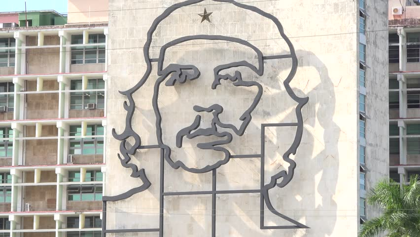 HAVANA,CUBA-JULY 14,2014: The Interior Ministry Building (MININT) in the Revolution Square or plaza, featuring a large Cuban flag and a Che Guevara work of art