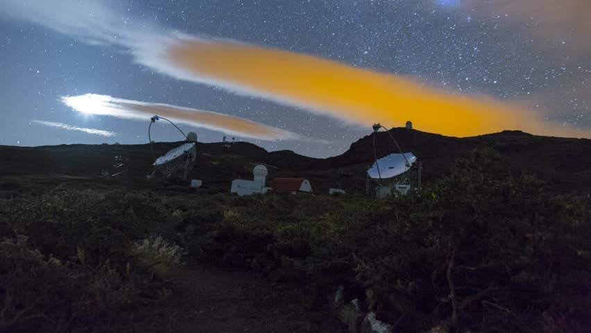 Timelapse of the Magic Mirror telescopes and the night sky, at the European Space Agency's facility on La Palma.  With motion controlled dolly movement.