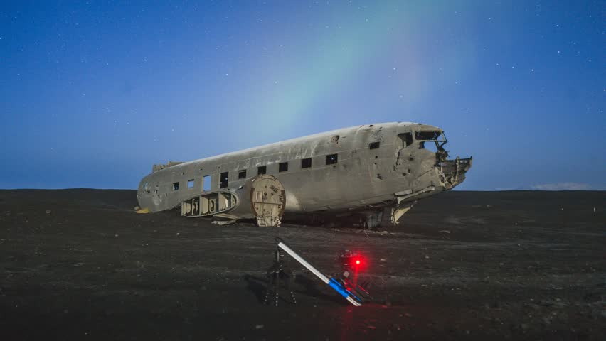 Filming the plane wreck with aurora (northern lights) at Solheimasandur in Iceland. BTS shot of camera on motion control dolly.