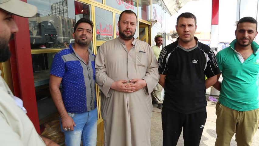 Baghdad, Iraq, October 2014: Iraqi Men Wearing Both Traditional and Western Clothing in Baghdad, Iraq, October 2014