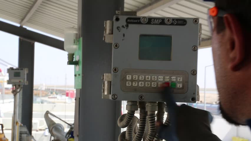 Basra, Iraq, October 2014: Iraqi Worker Pushes Buttons to Fill Tankers at Fuel Terminal in Basra, Iraq, October 2014.