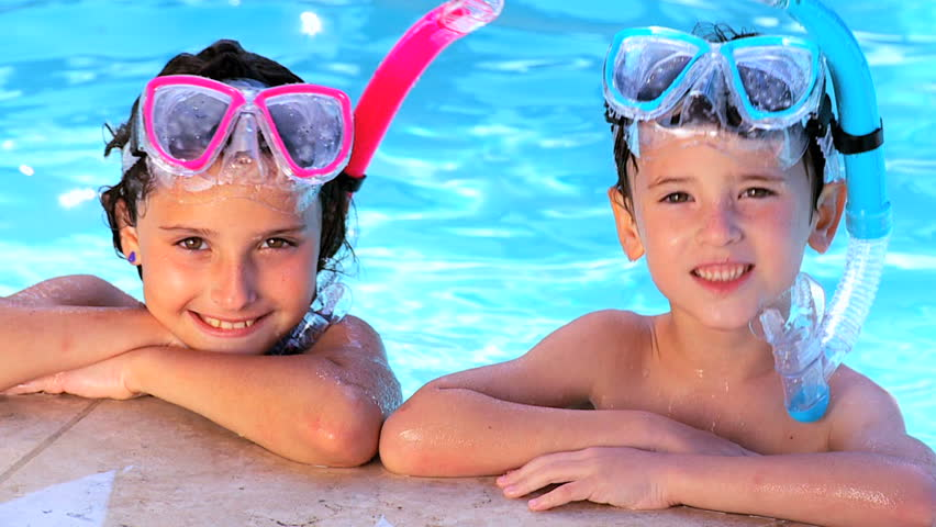 Young children having fun in their family swimming pool 60 FPS