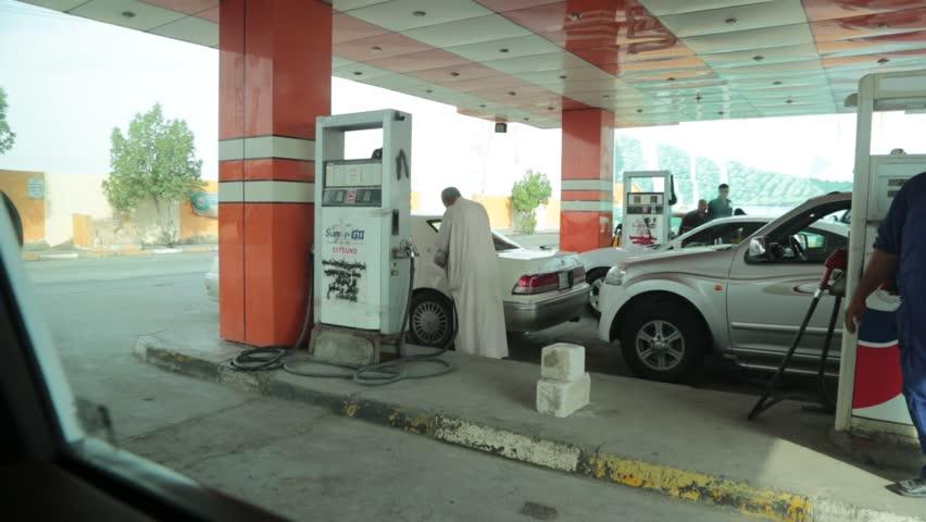 Basra, Iraq, October 2014:   Scene of Iraqi Petrol (Gas) Station Worker Basra, Iraq, October 2014: