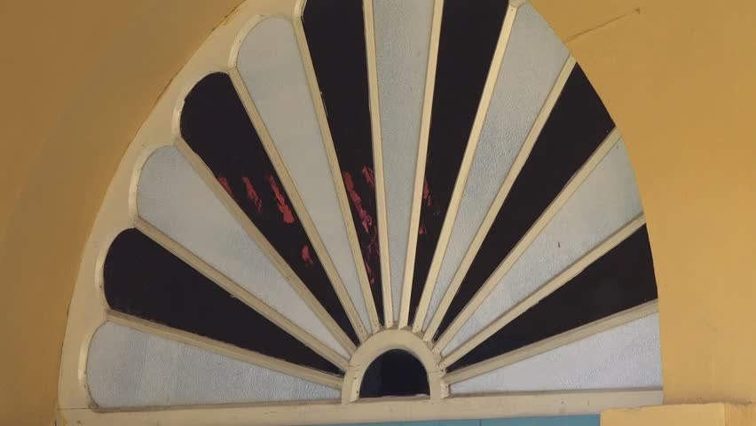 Colonial stained glass arch over a door in a well conserved colonial house