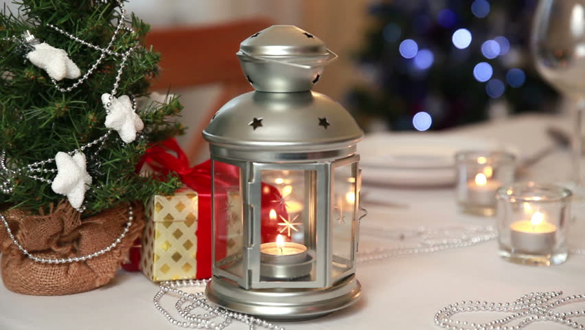 Christmas theme festive table setting with candles gifts - Table gifts for christmas ...