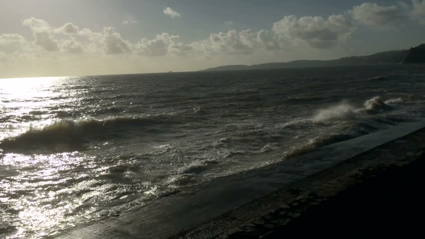 Travelling on the South Devon Railway line on the sea wall - with waves crashing into the sea defences as the train travels west in the morning.