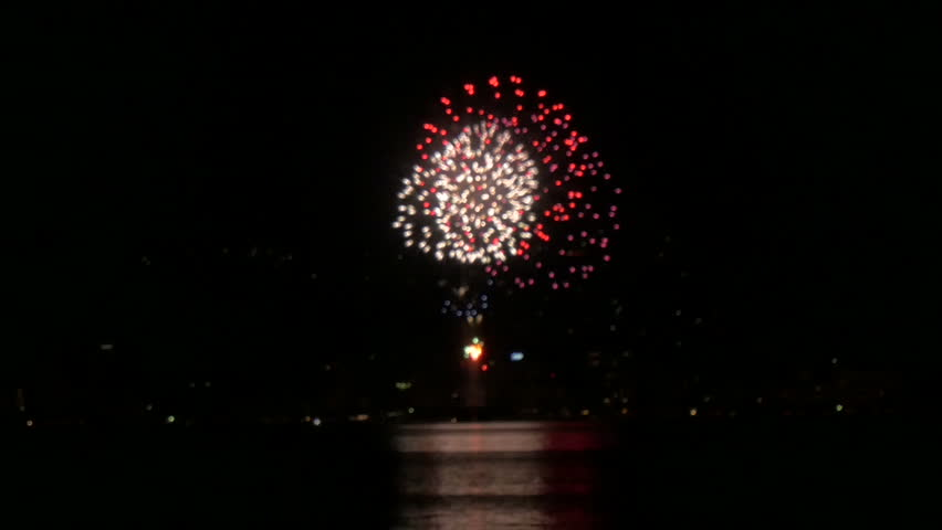 Celebration fireworks action over the lake in motion.