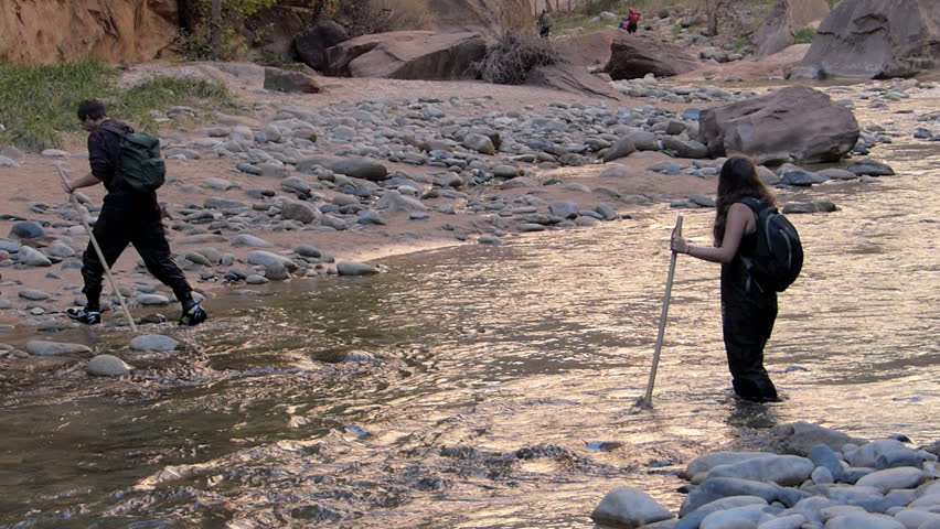 Zion National Park, USA – November 11, 2014: Hikers Hiking near a river in Zion National Park, Utah.