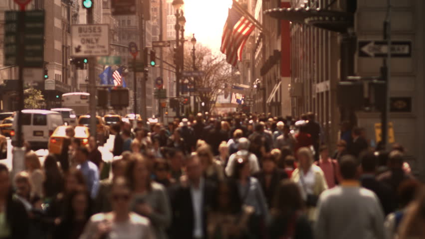 Anonymous crowd. Daytime. High angle.