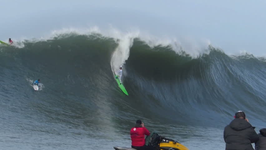 Half Moon Bay, California, USA – Jan. 24, 2014: Professional Surfer, Nic Lamb crashes while surfing on a giant wave during the Mavericks Invitational surf competition.