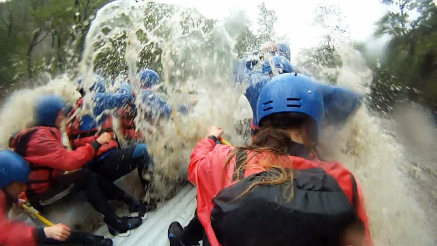 River Rafting is an extreme and fun sport. Splashing in whitewater. Go pro clip. - HD stock footage clip