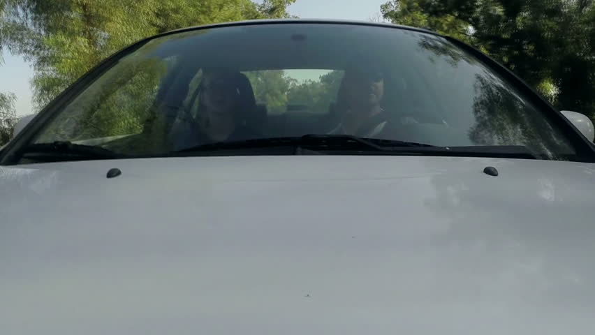 Couple driving car. Slow-motion