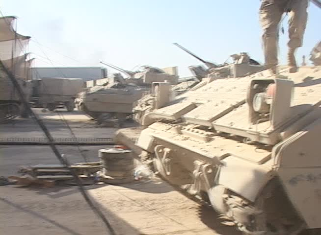 Iraq, Circa 2009: A U.S. Army Soldier steps off of a Bradley Fighting Vehicle,M6 LInebacker in Iraq, Circa 2009
