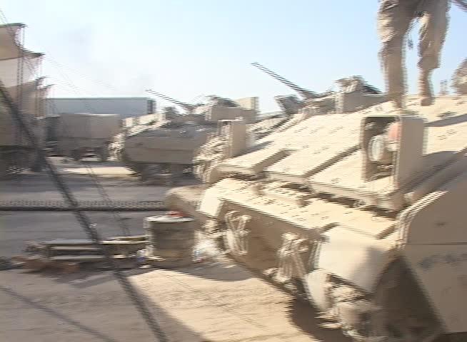 Iraq, Circa 2009: A U.S. Army Soldier steps off of a Bradley Fighting Vehicle,M6 LInebacker in Iraq, Circa 2009