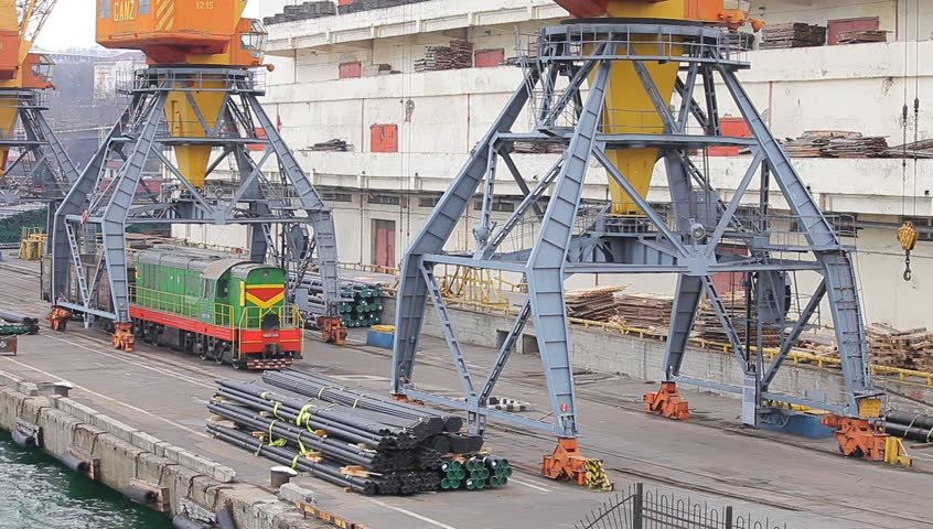 On November 26 - 2014 Odessa, Ukraine. The shunting locomotive of ChME-3 goes on the mooring of the Odessa seaport and transports to the car on loading under cranes. Odessa seaport Ukraine.