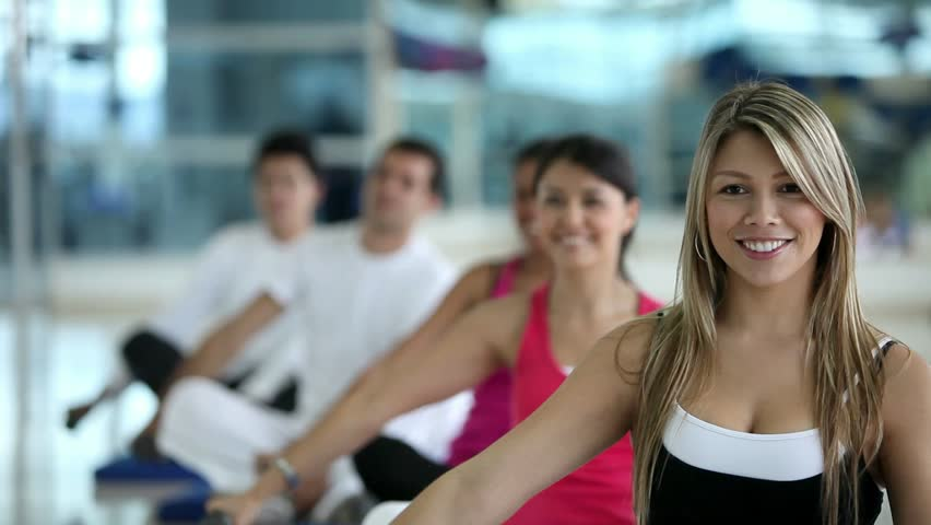 Group of people exercising at the gym with free weights - HD stock video clip