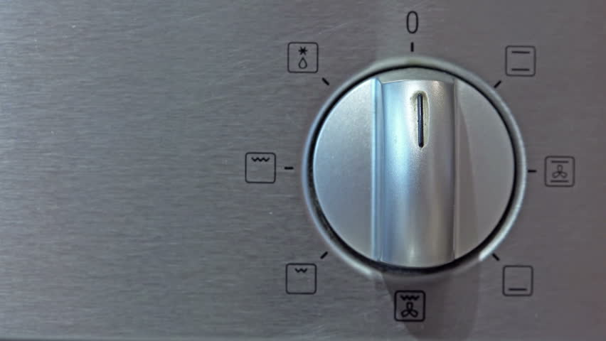 Metallic Toggle Switch of Cooker Oven. Close-up View. 4K Ultra HD 3840x2160 Video Clip