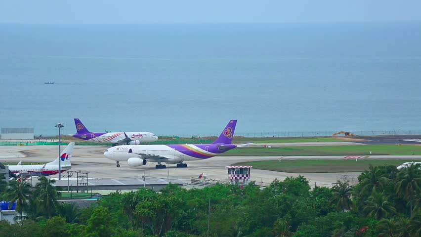 PHUKET, THAILAND - NOVEMBER 17, 2014: Thai Airways Airbus 330 and Thai Smile taxiing on Nov.17, International Phuket Airport, Thailand