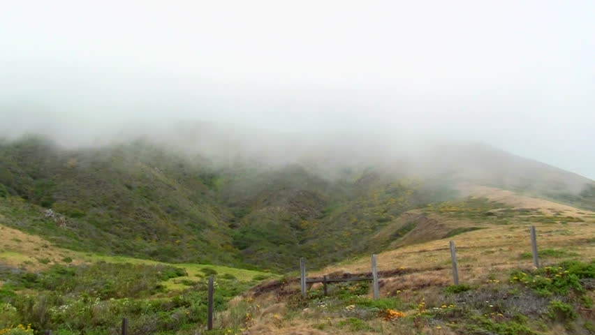 Ocean mist on coastal landscape  - HD stock footage clip