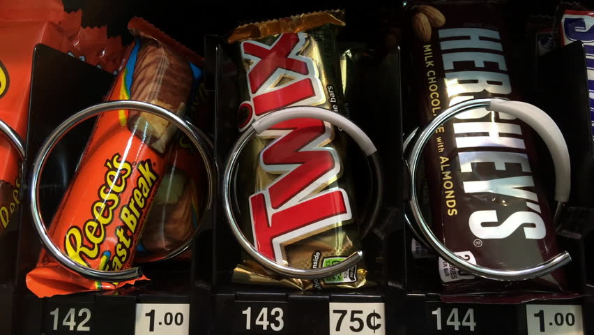 USA - APRIL: Buying Twix from Snack machine, a typical daily snack of someone in the United States of America, taken in April 2014.