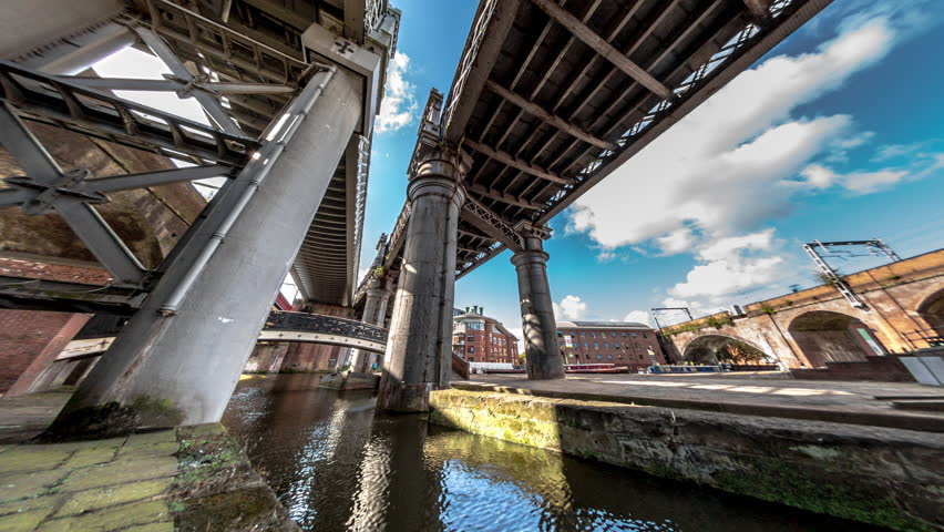 Time lapse of canal and bridges in Manchester near Deansgate lock.