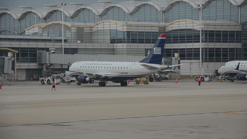 WASHINGTON - OCTOBER 3:US Airways passenger jet pushes back from the gate at Reagan National in Washington DC on October 3, 2014