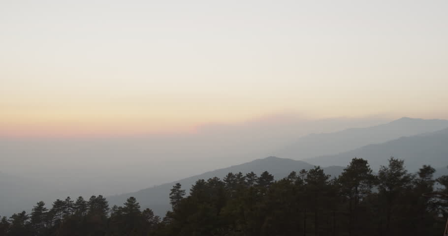 Time lapse of Kathmandu Valley sunset in Nagarkot, Nepal. Nagarkot is a famous hill station for it's beautiful views of the especially Mount Everest. Shot on Red Scarlet.