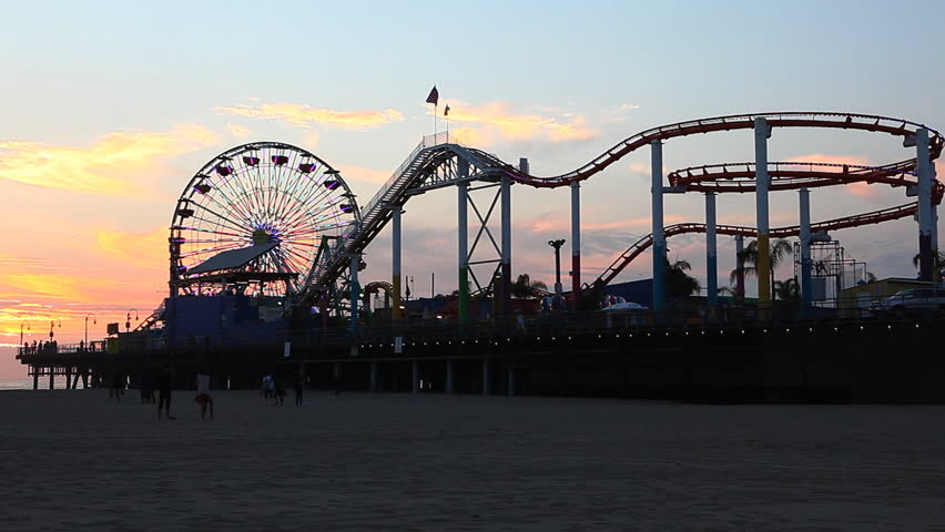 LOS ANGELES, CALIFORNIA/USA – JANUARY/2015: A night view of the attractions of the Santa Monica Pier [January 9, 2015] in [Los Angeles] - HD stock video clip
