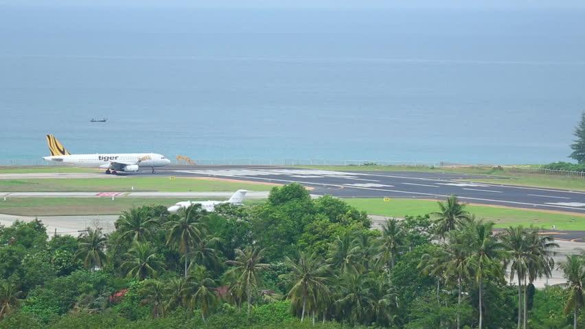 PHUKET, THAILAND - NOVEMBER 17, 2014: Tiger Airways Airbus 320 taxiing before take-off on Nov.17, International Phuket Airport, Thailand