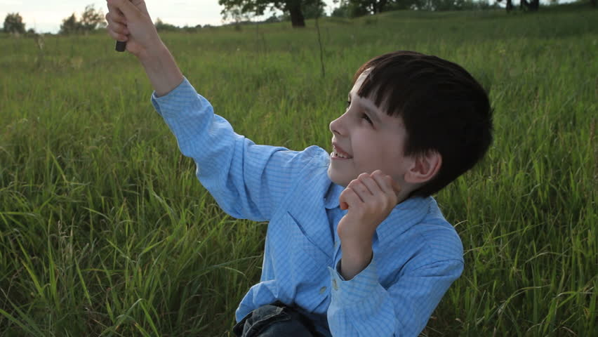 boy with magnifying glass  - HD stock video clip