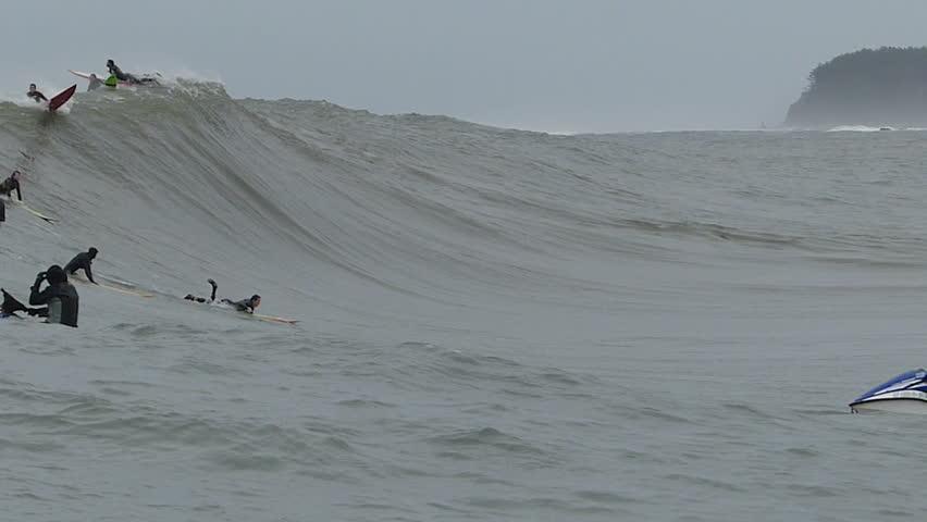 """Half Moon Bay, California, USA - Dec. 20, 2014: Big wave surfer, Ken """"Skindog"""" Collins, rides a giant wave at Mavericks surf break."""