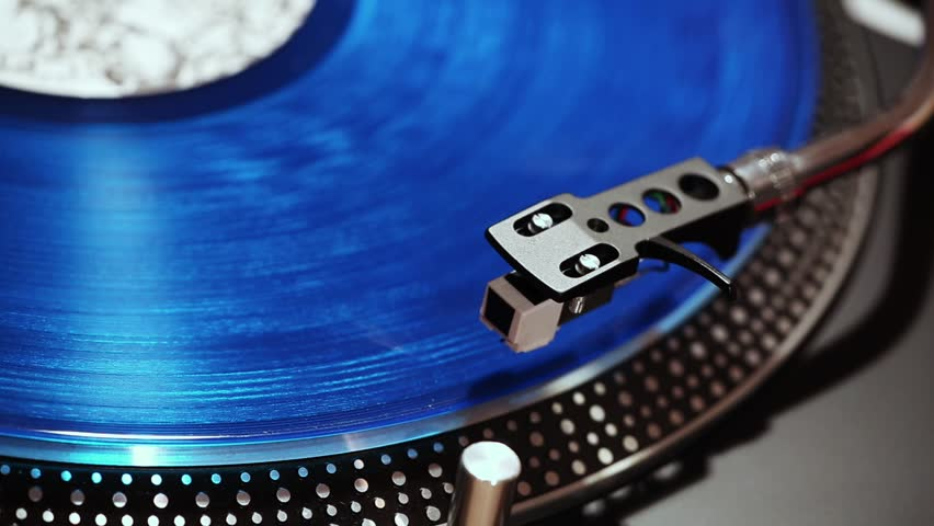 Gramophone record with blue vinyl, close-up .