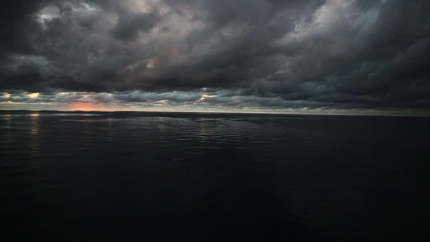 Dark storm clouds over open Caribbean ocean. 1080p HD.
