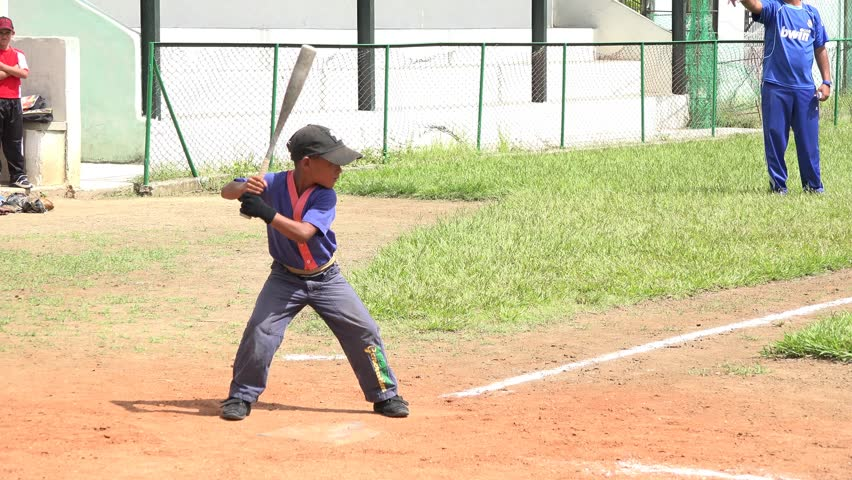 SANTA CLARA,CUBA-JULY 29,2014: Children training baseball in Cuba, since childhood they are carefully selected and placed in sport schools where they work everyday in improving their athletic skills.