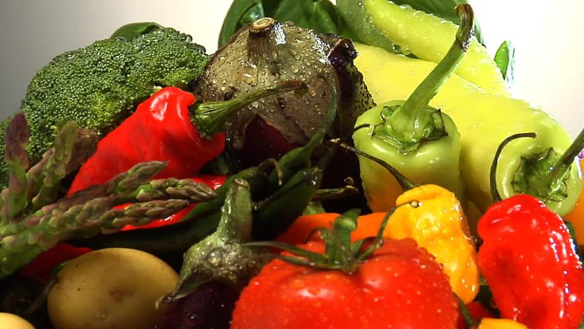 Assortment of fresh vegetables rotate in frame